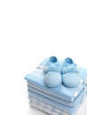 Baby boy shoes and swaddling blankets cute blue on a pile of isolated on white background Royalty Free Stock Image