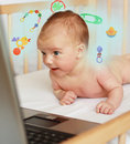 Baby boy shopping on-line Stock Photos