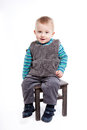 Baby boy sittin on a chair Stock Image