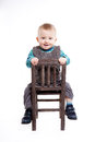 Baby boy sitting on a chair Royalty Free Stock Photos