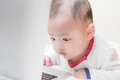 Baby boy starring at laptop Royalty Free Stock Photo