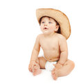 Baby boy in stetson hat portrait of adorable child sitting down and wear large cowboy isolated on white background having fun Stock Photo