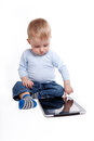 Baby boy with tablet one year old playing Royalty Free Stock Image