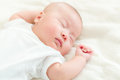 Baby boy take nap lying on bed Royalty Free Stock Photography