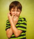 Baby boy teenager feels fear anxiety bad habit Royalty Free Stock Photo