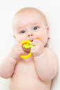 Baby boy with teether lying Royalty Free Stock Images