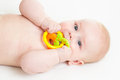 Baby boy with teether lying Stock Photo