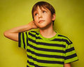 Baby boy thinks kid looking disheveled thoughts Royalty Free Stock Photo
