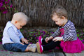 Baby boy and toddler girl playing outdoors Stock Photography