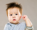 Baby boy touch his ear Royalty Free Stock Photo