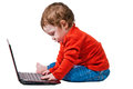 Baby boy typing Alt-Ctrl-Del on laptop Stock Image