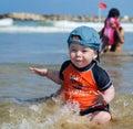 Baby boy water splash cute at the beach Stock Photos