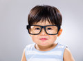 Baby boy wear glasses with gray background Stock Photos