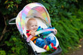 Baby boy in white stroller Royalty Free Stock Photo