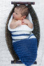 Baby boy in a wicker basket Royalty Free Stock Photography