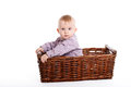 Baby boy in a wicker basket Stock Images