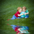 Baby boys on grass Stock Image