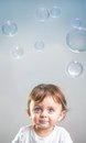Baby and bubbles smiling looking up to the in the air Royalty Free Stock Photos