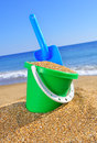 Baby bucket with sand and a shovel Royalty Free Stock Photo