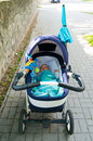Baby buggy sidewalk lying in a on a Royalty Free Stock Photo