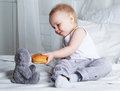 Baby with a bun Royalty Free Stock Photo
