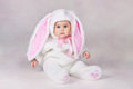 Baby in bunny costume small child a white Stock Photos