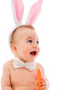 Baby with bunny ears and carrot Stock Images
