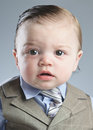 Baby businessman a month old dressed in a suit Stock Image