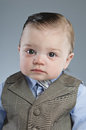 Baby businessman a month old dressed in a suit Royalty Free Stock Photos