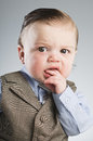 Baby businessman a month old dressed in a suit Royalty Free Stock Image