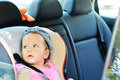 Baby in car girl sitting Stock Images