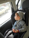 Baby in car seat for safety Stock Images