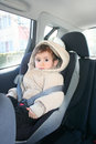 Baby in car seat for safety looking carefully Royalty Free Stock Photo
