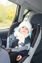 Baby in car seat for safety looking carefully Stock Images