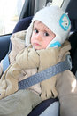 Baby in car seat for safety looking carefully Stock Image