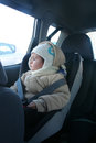 Baby in car seat for safety looking outside Stock Images