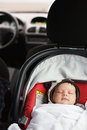 Baby car seat a sleeping in a special Stock Image