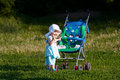 Baby with carriage Royalty Free Stock Photography