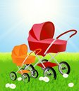 Baby carriages on beautiful summer field Stock Photos