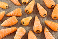 Baby carrots group of spread on a jute sack background Stock Images