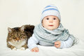 Baby and cat good friends with Stock Images