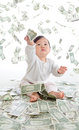 Baby catch money rain in the air Royalty Free Stock Image