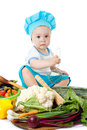 Baby Chef and vegetables Stock Photo