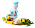 Baby Chef and vegetables Stock Images