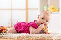 Baby chewing on teething toy Royalty Free Stock Photo