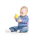 Baby child drinking from bottle girl Royalty Free Stock Photos