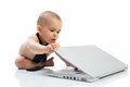 Baby child playing with computer Royalty Free Stock Photo