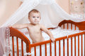 Baby in a children s bed portrait of the child Stock Photography