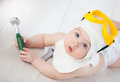 Baby chooses a profession mechanic Stock Image