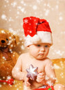 Baby in Chrismtas hat Royalty Free Stock Image